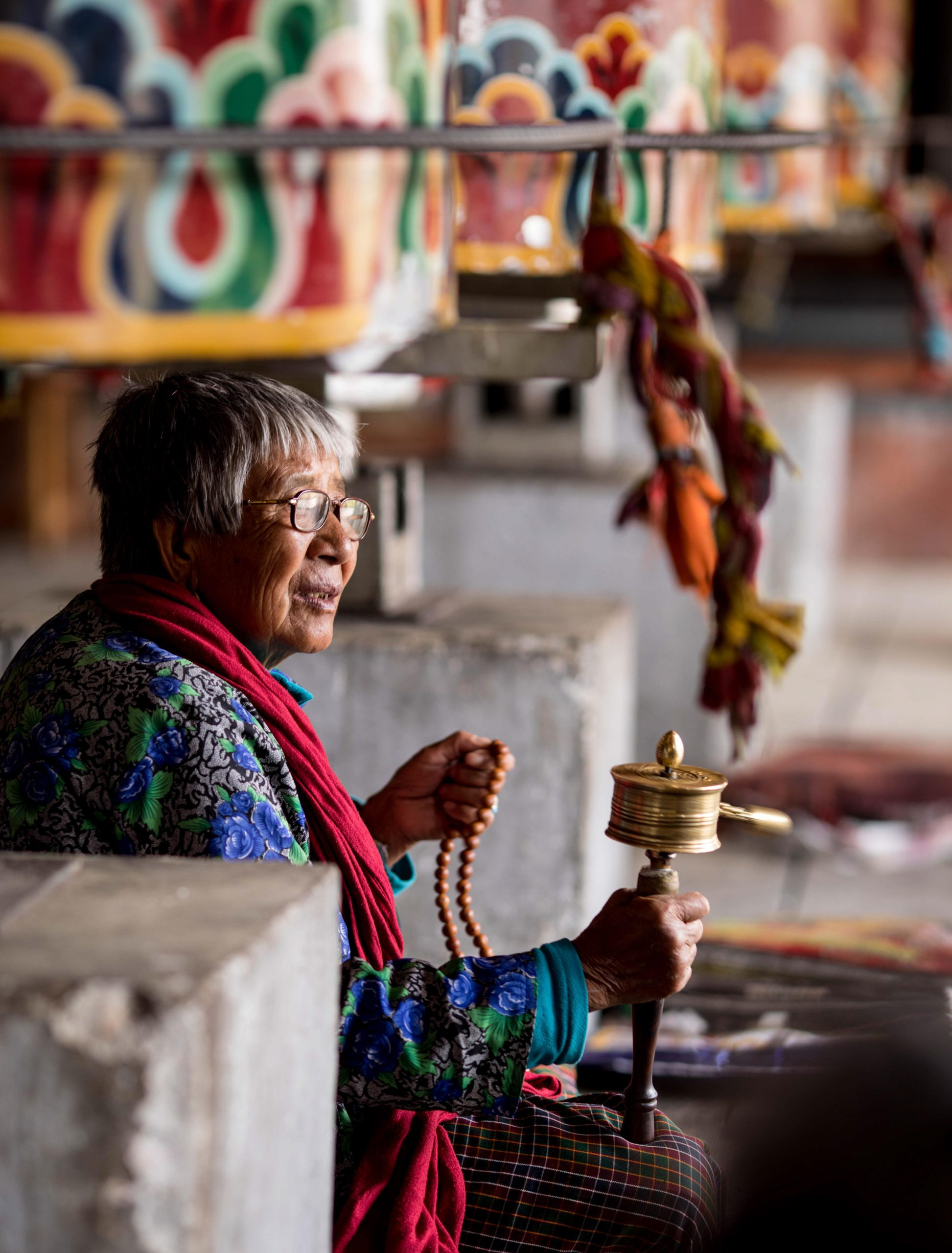 The Old Bhutanese Women with A Prayer Wheel